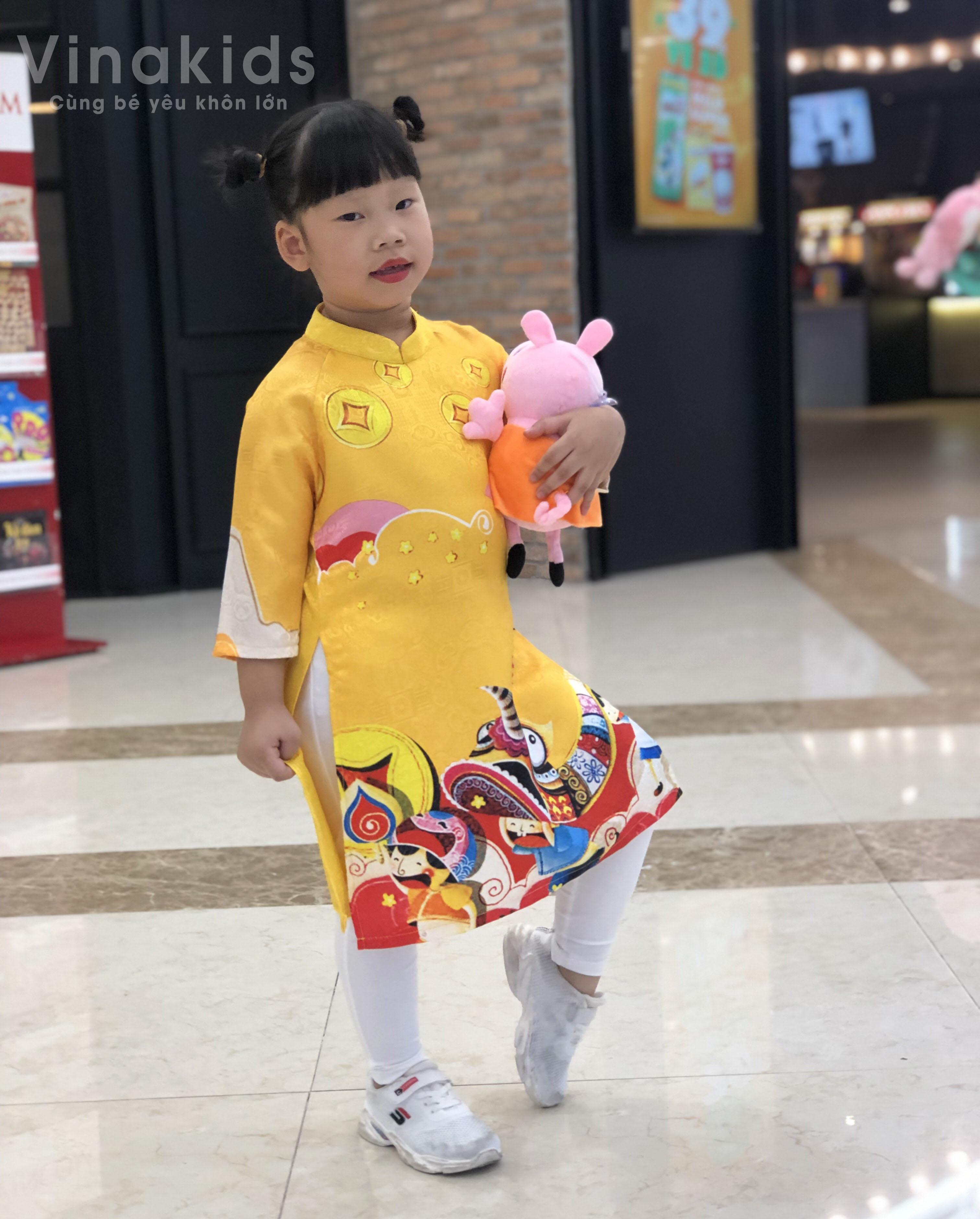 Set áo dài cách tân bé gái Vinakids họa tiết tết màu vàng kèm quần (2-14 tuổi)