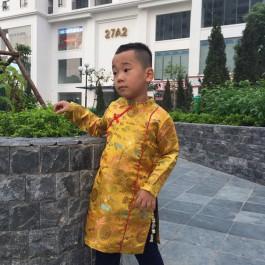 Áo dài bé trai cách tân màu vàng